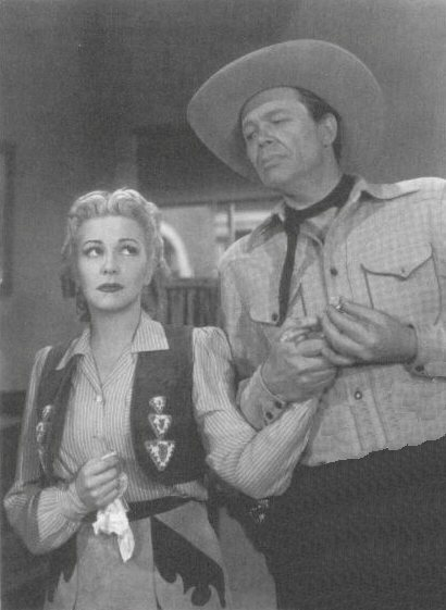 Christine as Nell and Dick Curtis as Badlands Blackie in 1946's THREE TROUBLEDOERS