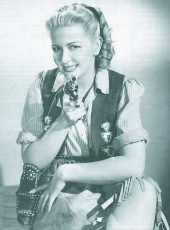 Christine in a publicity still from the 1946 comedy short THREE TROUBLEDOERS align=