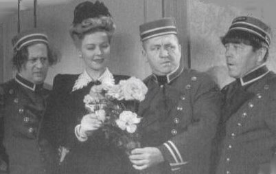 Larry Fine, Christine, Curly and Moe Howard in a publicity still for 1944's IDLE ROOMERS